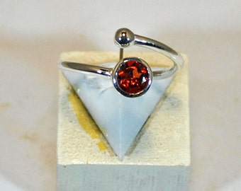 Fine adjustable sterling silver ring with garnet setting