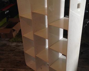Design Bookshelf in white plexi