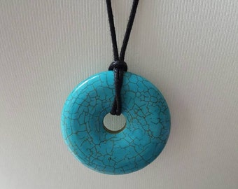 Jade doughnut stone with a leather thong