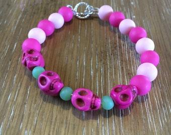Matte pink and green skull bracelet