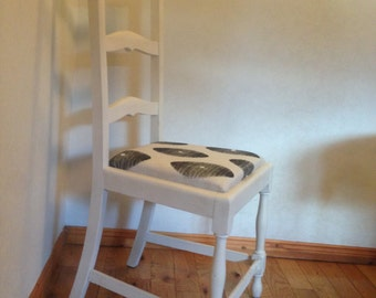 Ladder backed cream distressed chair