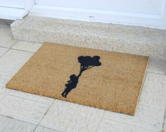 Banksy-style Flying Balloon Girl quirky doormat - 60x40cm