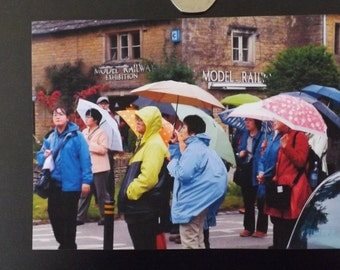 Japanese Tourists in the Rain at Bourton-on-the-Water. Blank Card.Quality.