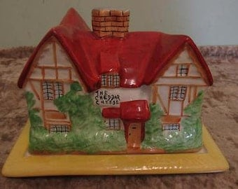 This is a lovely vintage Crown Devon 'The Cheddar Cheese' Lidded Cheese Dish in the shape of a cottage.