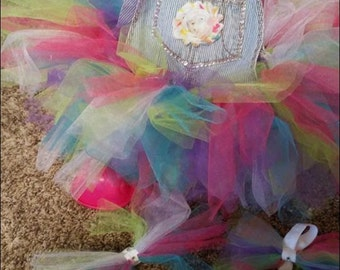 Birthday tutu with headband and barefoots.