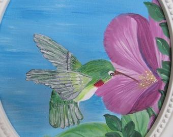 Hummingbird in oval