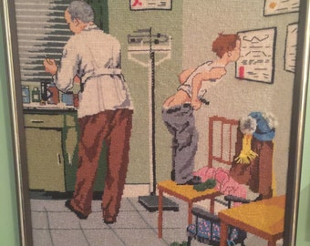 Vintage Norman Rockwell cross stitch completed and framed