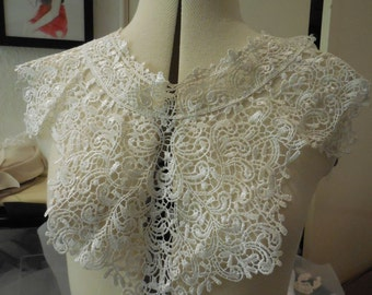A white floral cotton lace collar applique / Round shape neckline collar motif is for sale. Sold by per piece