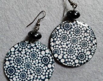 Handmade earrings and white wood