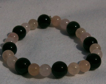 Morganite and onyx stretch bracelet
