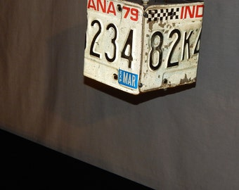 Old Indy 500 license plate pendant with checkered flag canopy