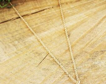 Goldtone Quatrefoil and Pearl Pendant Necklace