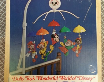 Vintage dolly toy's wonderful world of disney musical mobile - original box - featuring mucky mouse, dopey, doc, pinnochio and jiminy