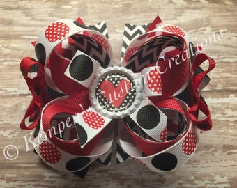 A  Black, white and red OTT bow
