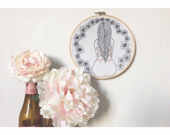Hoop embroidered; Shibari and asian flowers.