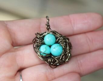 turquoise eggs bird nest charm