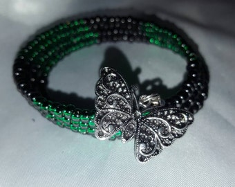 Green glass bead bracelet with butterfly Charm