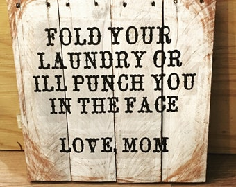 Fold your laundry or I'll punch you in the face sign.