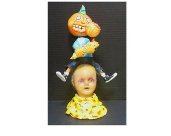 Creepy Little Doll Head Candy Container
