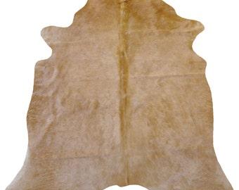 shades of beige cowhide rug
