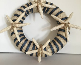 """Beach themed straw 10"""" wreath wrapped in burlap and ribbon and seashells"""