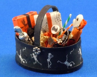 Dollhouse Miniature Halloween basket filled with goodies in twelfth scale, 1:12 scale  Item #121.