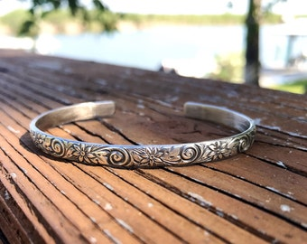 Sterling silver engraved flower cuff