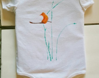 onesie painted with elegant orange bird on turquoise reeds