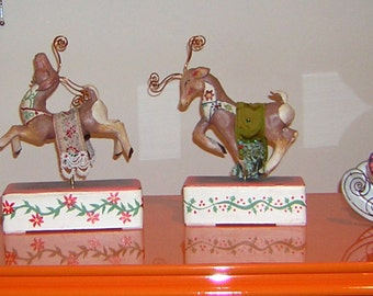 Santa Claus with reindeers and sled. Handmade in ceramic.
