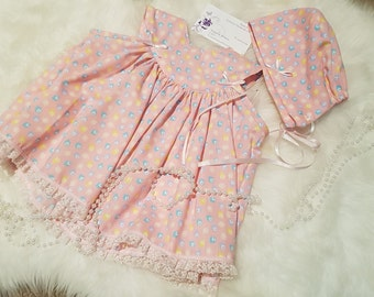 Baby girl pink cotton dress and bonnet set