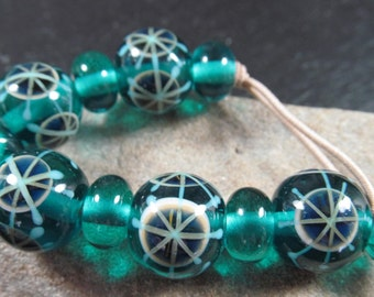 Teal and cobalt cartwheels lamwork bead set