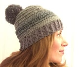 Soft crochet ombre beanie in shades of green and gray with optional pom pom