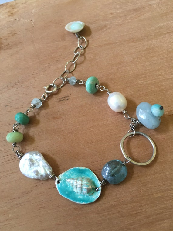 Fine silver with enamel shell, pearl, apatite, aquamarine and green moss opal; chain length 9 imcges (adjustable)