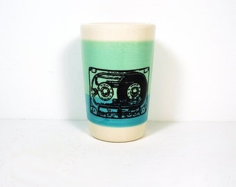 itty bitty cylinder in colour block of blue green & turquoise blue, with a mixtape on it, made to order.