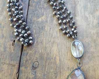Jennifer Double Strand knotted crystals with large soldered faceted crystal