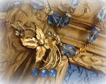 archipelago one of a kind vintage assemblage necklace deco era faceted sapphire blue + topaz crystals gold filled pendant with rhinestones