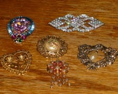 Lot of six (6) brooches.  Five are vintage and one is handmade from found pendant