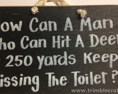 How can man hit deer at 250 yards keep missing toilet sign wood