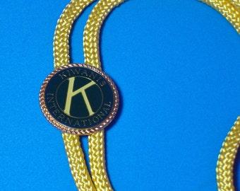 Vintage Kiwanis International Gold Yellow Bolo Necklace Insignia Slide 1970s