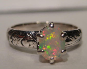 Natural  Ethiopian Opal Sterling Silver  ...... size 6 1/2  ............    e832