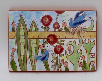 nesting hand carved ceramic art tile