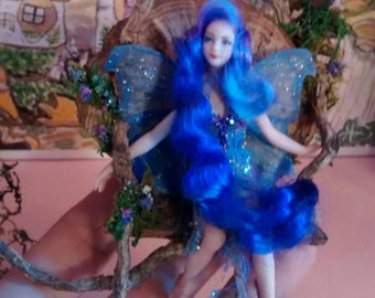 Faerie on a Swing Porcelain Fairy and Deer OOAK With Silk Dress Made from Iris Dye Tree Stump Roots and Mushrooms