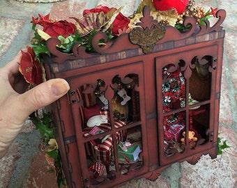 1:12 scale Miniature Christmas Scene Inside a Miniature Curio Cabinet with a Fireplace and Mounted Deer Head