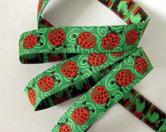 2 yards LADYBUGS Jacquard trim in red, black on green. 5/8 inch wide. 2026-A