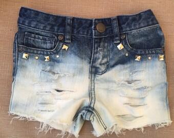 Custom distressed denim shorts