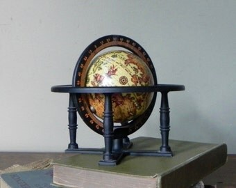 Vintage small desk accessory globe on metal base spins