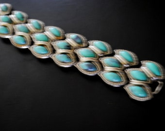Boho vintage 70s silvertone metal , cuff bracelet with a three rows of the faux, teal color turquioses.SIZE 7.