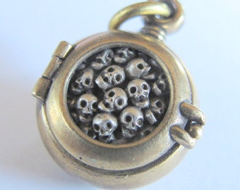 steampunk mourning locket  SKULL LOCKET bronze with sterling silver skulls