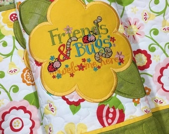 Quilted Placements . . . Set of 2 . . . Appliquéd Center Flower . . . Embroidered FRIENDS and BUGS Welcome Here