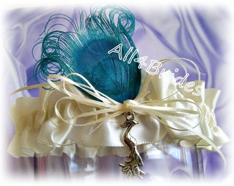 Peacock weddings bridal garter, something blue, blue peacock feather and peacock charm.